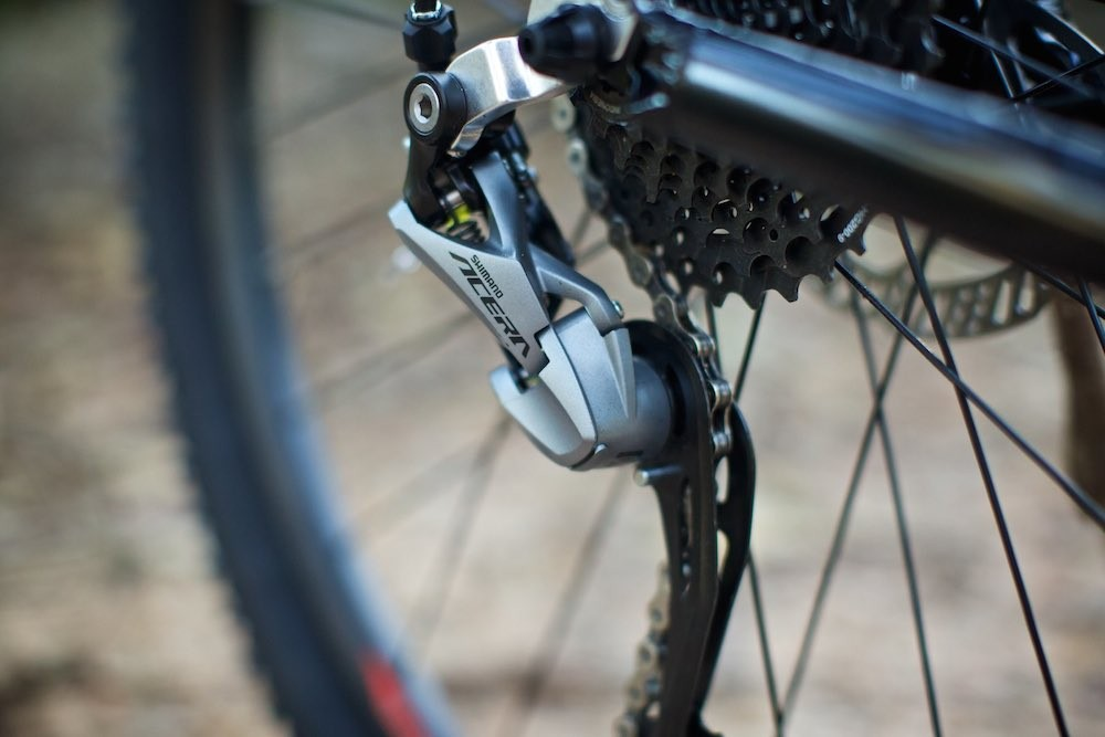 Shimano Acera 9-speed derailleurs work with 10-speed gearing.