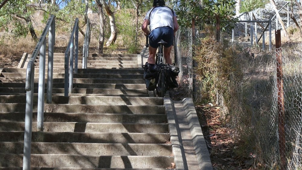 Bicycle Touring Up Stairs